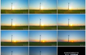 4K实拍视频素材丨夕阳西下映照着草地上转动的风力发电机