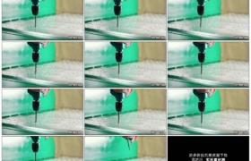 高清实拍视频素材丨特写用电钻给金属板材打孔