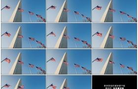 4K实拍视频素材丨仰拍美国华盛顿哥伦比亚特区国家广场中心华盛顿纪念碑前随风飘扬的美国国旗