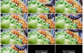 高清实拍视频素材丨特写女子在超市水果货架上选购水果