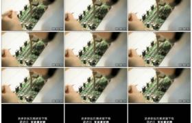 高清实拍视频素材丨特写维修工用电烙铁焊接电路板上的元件