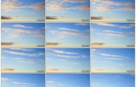 高清实拍视频素材丨清晨朝霞从蓝色的天空中飘过延时摄影