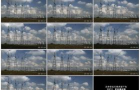 高清实拍视频素材丨蓝天流云下的高压电力塔及远处的发电站