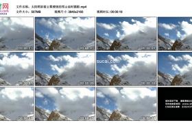 4K实拍视频素材丨太阳照射着云雾缭绕的雪山延时摄影