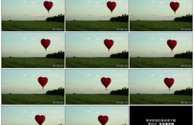 高清实拍视频素材丨红色心形热气球慢慢降落