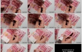 4K实拍视频素材丨特写一张一张的100元人民币 数钱
