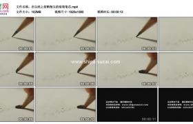 高清实拍视频素材丨在白纸上按断削尖的铅笔笔芯
