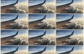 高清实拍视频素材丨飞机飞行在高空 舷窗外的机翼和云层
