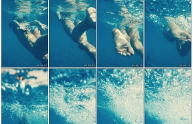高清实拍视频素材丨水下摄影 女子在泳池中游泳激起水泡1080×1920竖幅