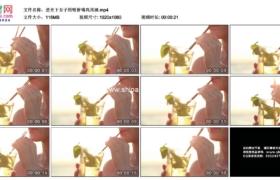 高清实拍视频素材丨逆光下女子用吸管喝鸡尾酒