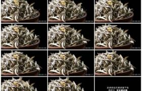 高清实拍视频素材丨特写细长的茶叶从高处掉落