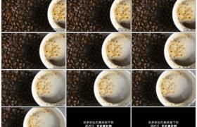 4K实拍视频素材丨顶视角从咖啡豆摇摄到一杯冒着热气的咖啡