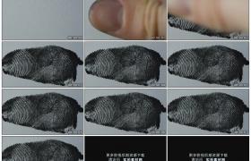 高清实拍视频素材丨特写在白色的纸张上印上黑色的拇指指纹