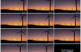 高清实拍视频素材丨夕阳中发电场上转动的风力发电机