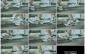 高清实拍视频素材丨特写在跑步机上跑动的男子的脚慢镜头