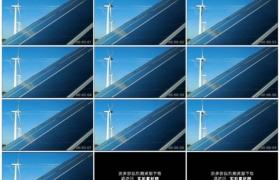 4K实拍视频素材丨晴天阳光照射下的太阳能电池板及转动的风力发电机