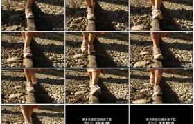 高清实拍视频素材丨低角度跟拍女子行走在铁轨上