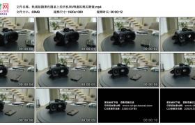 高清实拍视频素材丨轨道拍摄黑色圆桌上的手机和VR虚拟现实眼镜