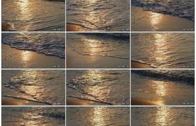 高清实拍视频素材丨阳光照射着的海浪轻拂着沙滩