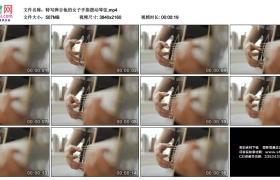 4K实拍视频素材丨特写弹奏吉他的女子手指拨动琴弦