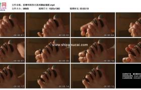 高清实拍视频素材丨按摩师将热石放到脚趾缝隙