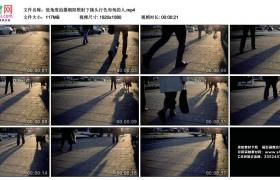 高清实拍视频丨低角度拍摄朝阳照射下街头行色匆匆的人
