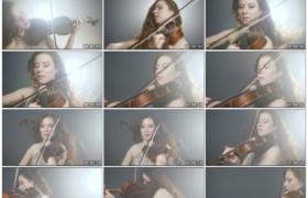 4K实拍视频素材丨聚光灯下才华横溢的长发女外国小提琴手