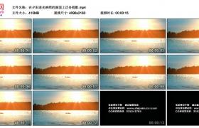 4K实拍视频素材丨在夕阳逆光映照的湖面上泛舟剪影