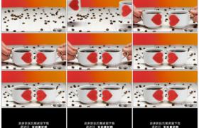 高清实拍视频素材丨将两杯贴着红色桃心的咖啡杯放到撒着咖啡豆的桌面上