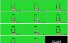 4K实拍视频素材丨绿色背景前手拿着绿屏的手机展示信息