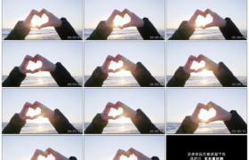 4K实拍视频素材丨海边阳光照射着比着心形的手