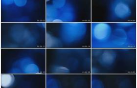 高清动态视频素材丨蓝色背景上抽象炫光颗粒