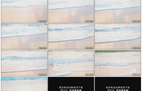 高清实拍视频素材丨低角度拍摄波浪席卷沙滩