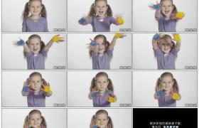 4K实拍视频素材丨可爱的小女孩晃动着沾着颜料的双手手掌