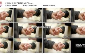 4K实拍视频素材丨特写女子紧握着男友的手指