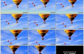高清实拍视频素材丨热气球在晴朗的天空中飞行