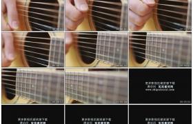高清实拍视频素材丨特写吉他手手指拨动琴弦