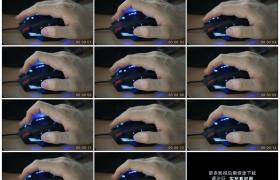 4K实拍视频素材丨特写手掌握着带led光效的鼠标并拨动滚轮