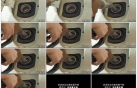 高清实拍视频素材丨特写手拿油枪给汽车加油