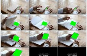 高清实拍视频素材丨镜头推近女子双手打开书本拿起带绿屏的照片