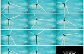 4K实拍视频素材丨特写蓝天下缓缓转动的风力发电机涡轮