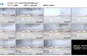 高清实拍视频丨环卫工人用高压水枪冲洗街道路面