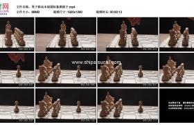 高清实拍视频素材丨男子移动木制国际象棋棋子