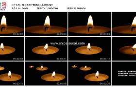 高清实拍视频素材丨特写黑暗中燃烧的三盏蜡烛