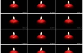 4K实拍视频素材丨黑暗中一支红色的蜡烛燃烧烛火摇曳