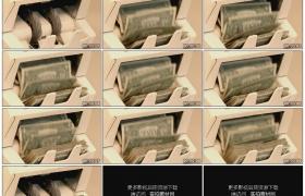 高清实拍视频素材丨特写用点钞机清点美金纸币