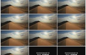 高清实拍视频素材丨太阳照射下风吹着沙漠沙丘上沙粒飞散