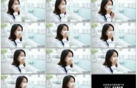 高清实拍视频素材丨特写戴着口罩的女子咳嗽