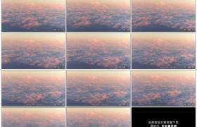 高清实拍视频素材丨飞机在阳光照射的红色云海上飞行