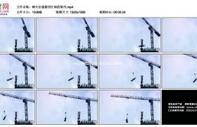 高清实拍视频素材丨晴天在建楼顶忙碌的塔吊